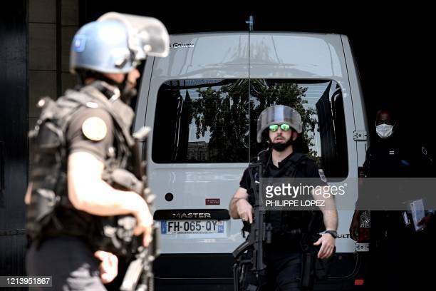 TOPSHOT French Gendarmes stand guard next to a prison van transporting Felicien Kabuga one of the last key fugitives wanted over the 1994 Rwandan...