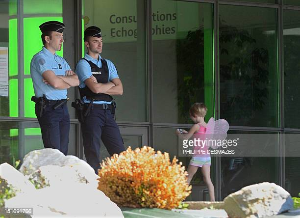 French gendarmes stand guard on September 10 2012 at the entrance of the Grenoble's CHU Hospital French Alps where the elder of two child survivors...