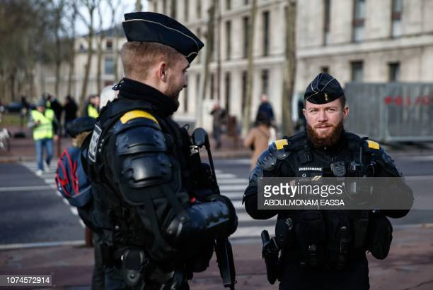 French gendarmes stand in a street during a 'Yellow Vests' demonstration on December 22 2018 in Versailles The 'Yellow Vests' movement in France...