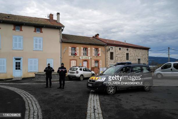 French Gendarmes stand in front of the city hall in Saint-Just, central France on December 23 after three gendarmes were killed and a fourth wounded...