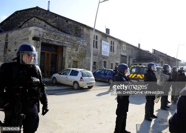 French gendarmes stand in front of the 'House of Resistance against Nuclear Waste' in Bure northeastern France on February 22 2018 French gendarmes...