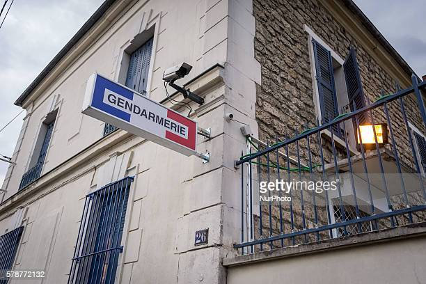 French Gendarmes stand in Persan, on July 21 2016 after a second night of violence in a row, with 15 cars set ablaze by residents furious over the...