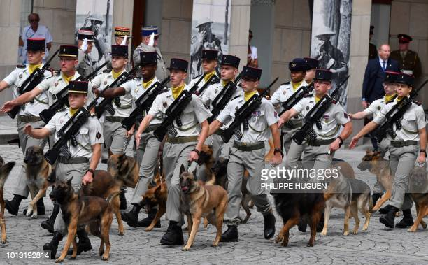 French gendarmes walk with their dogs in Amiens northern France on August 8 during a ceremony to mark the 100th anniversary of the World War I Battle...