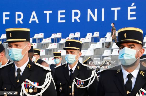 French Gendarmes wearing protective facemasks arrrive prior to the annual Bastille Day military ceremony on the Place de la Concorde in Paris, on...