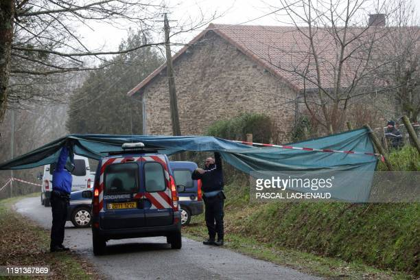 French gendarms are seen in front of a perimeter set up around a property in Beynat, near the village of Saint-Leonard-de-Noblat, east of Limoges, on...