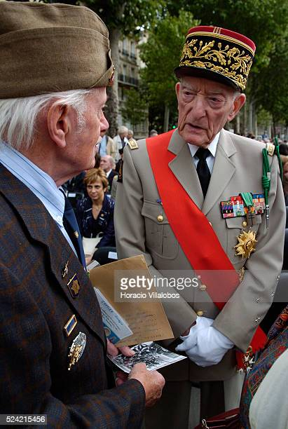 French General Alain de Boissieu son in law of Charles De Gaulle chats with a veteran at the first homage to Republican Spanish combatants who fought...