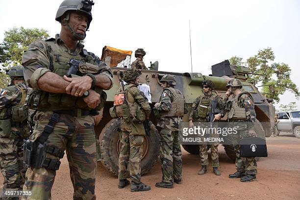 French General Francisco Soriano commander of the Sangaris operation talks to soldiers in Bangui on December 28 2013 More than 1000 people are...