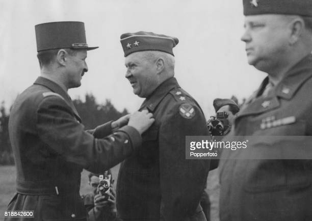 French general Philippe François Marie Leclerc de Hauteclocque presents Major General Wade H Haislip of the US Army with the medals of the Chevalier...