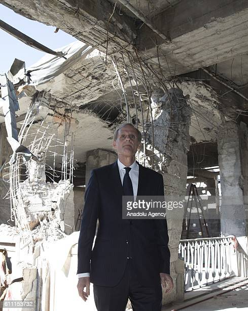 French General Secretary at the Ministry for Foreign Affairs and International Development Christian Masset inspects interior parts of the Grand...