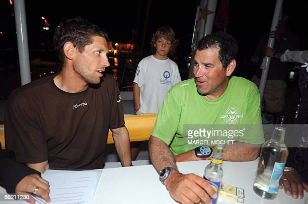 French Gildas Morvan skipper of monohull Cercle Vert speaks with Frenck Erwan Tabarly skipper of monohull Athema on April 25 2009 upon their arrival...