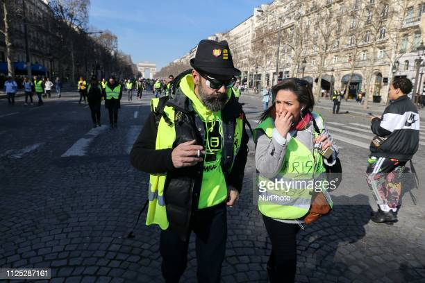 French Gilet Jaune movement leader Jerome Rodrigues walks on the Champs Elysées during a Yellow vest antigovernment demonstration on February 16 2019...