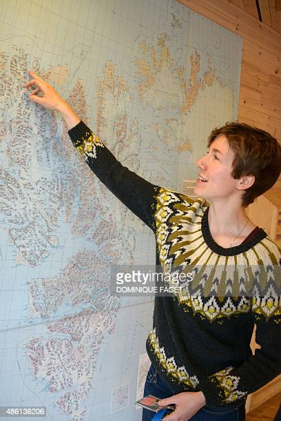 French glaciologist Heidi Sevestre shows a map as she works at the university of Longyearbyen on July 24 2015 AFP PHOTO / DOMINIQUE FAGET