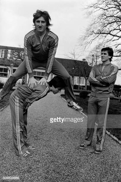French goalkeeper André Rey the biggest man of French football team plays leapfrog with his teammate Loïc Amisse as Patrick Patisson looks on on...