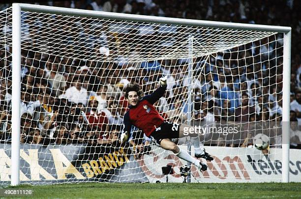 French goalkeeper JeanLuc Ettori jumps for the ball during the 1982 World Cup semifinal football match between West Germany and France on July 8 1982...