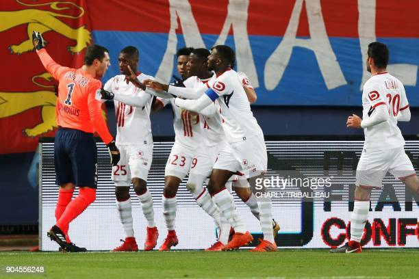 French goalkeeper Remy Vercoutre argues with Lille's players after conceding a goal during the French L1 football match between Caen and Lille on...