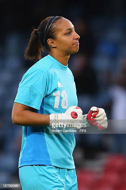 French goalkeeper Sarah Bouhaddi celebrates after Elodie Thomis of France scored during the Women's Football first round Group G Match of the London...