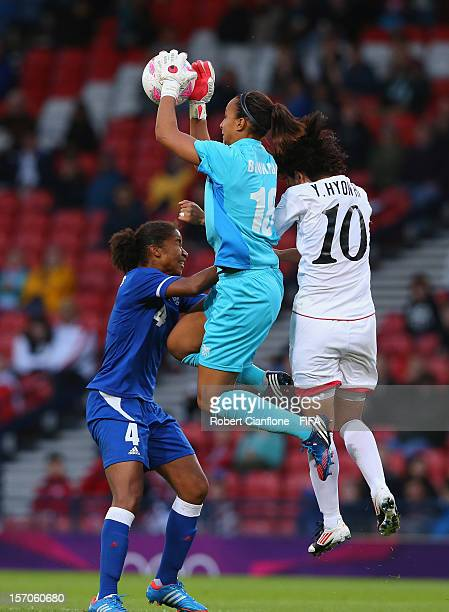 French goalkeeper Sarah Bouhaddi takes the ball during the Women's Football first round Group G Match of the London 2012 Olympic Games between France...