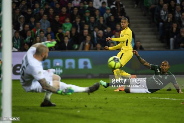 French goalkeeper Stephane Ruffier deflects a shot by Paris Saint-Germain's French forward Kylian Mbappe as Saint-Etienne's French defender Kevin...