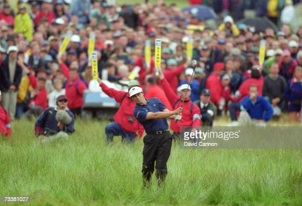 French golfer Jean Van de Velde takes his 5th shot from the rough at the 18th green in the final round of the British Open Championship at Carnoustie...