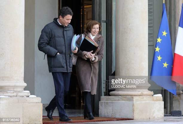 French Government's Spokesperson Benjamin Griveaux and French Defence Minister Florence Parly leave the Elysee palace following the weekly Cabinet...