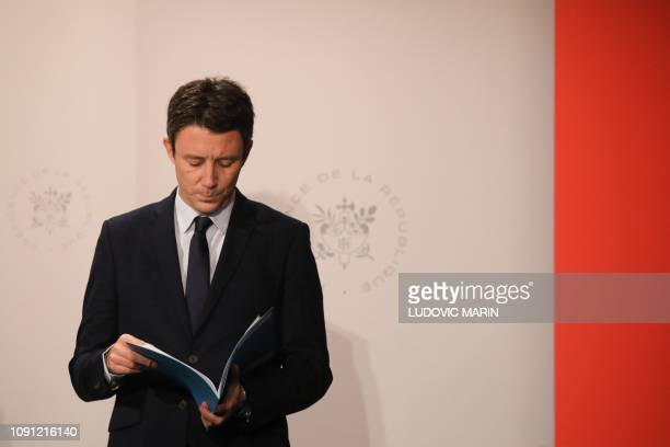 French Government's spokesperson Benjamin Griveaux reads in a document during a press conference following the weekly cabinet meeting at the Elysee...