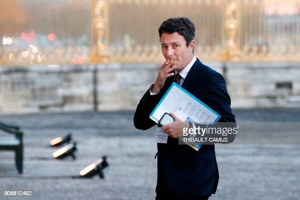 French Government's Spokesperson Benjamin Griveaux smokes a cigarette within the Choose France summit at the Chateau de Versailles near Paris on...