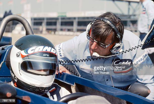 French Grand Prix driver Jean-Pierre Jarier talking with team owner Ken Tyrrell as he sits aboard the Candy Tyrrell Team Tyrrell 009 Ford Cosworth...