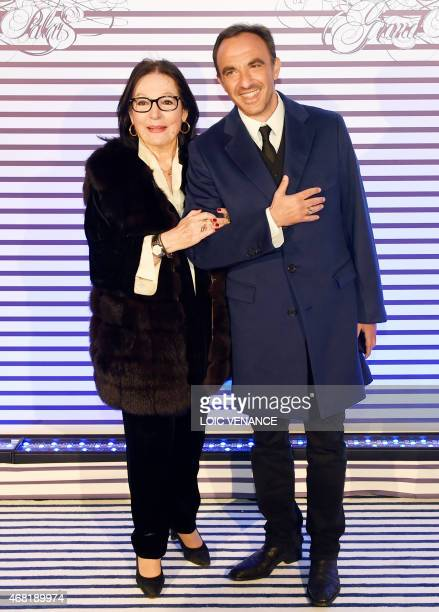 French Greek TV host Nikos Aliagas and Greek singer Nana Mouskouri pose as they arrive to attend a party to celebrate the French fashion designer...