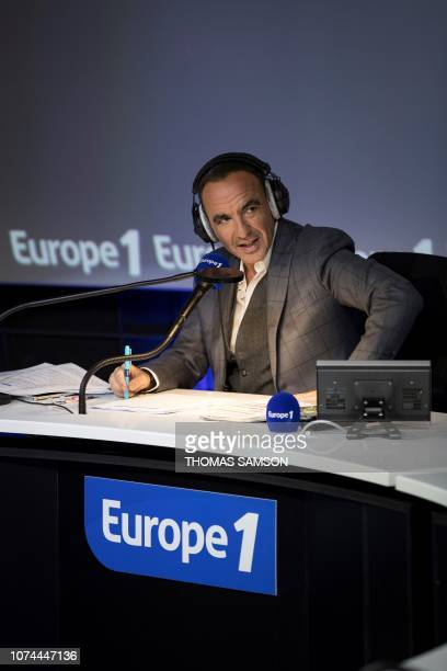 French Greek TV host Nikos Aliagas poses during the Europe 1 morning radio show 'Deux heures d'info' in the 'Pierre Bellemare' new studio in Paris on...