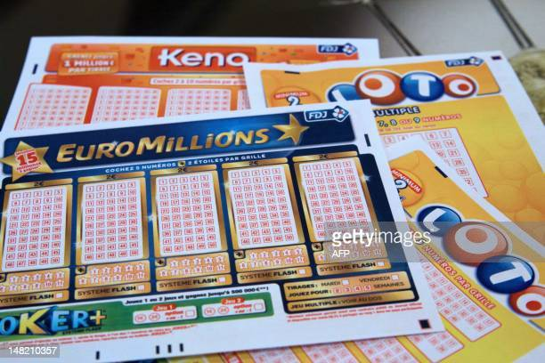 French grids of EuroMillions Loto and Keno by Francaise des Jeux the operator of France's national lottery games are pictured on July 12 2012 in...