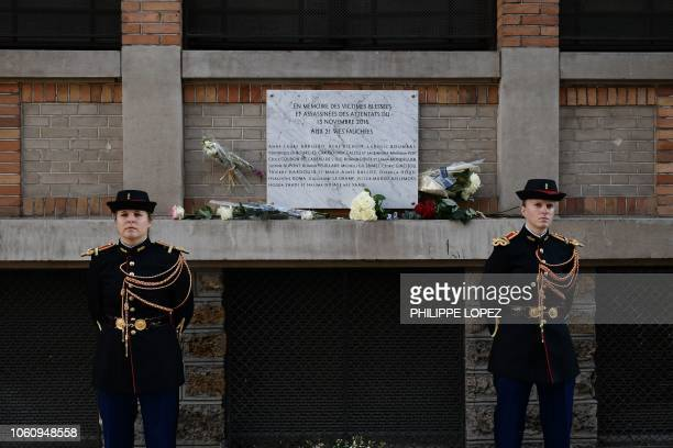 French guard stand by the commemorative plaque near the La Belle Equipe restaurant during a ceremony marking the third anniversary of the Paris...