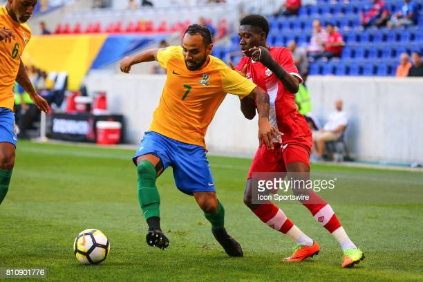 French Guiana defender Anthony Soubervie battles Canadian National Soccer Team midfielder Alphonso Davies during the first half of the CONCACAF Gold...