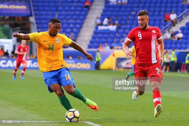 French Guiana defender Gregory Lescot and Canadian National Soccer Team forward Lucas Cavallini during the first half of the CONCACAF Gold Cup Group...