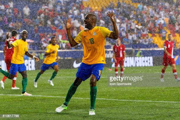 French Guiana forward Sloan Privat celebrates in the rain after scoring during the second half of the CONCACAF Gold Cup Group A game between the...