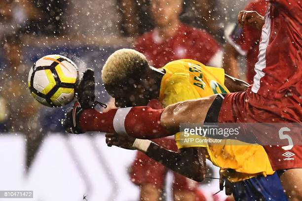 TOPSHOT French Guiana's forward Arnold Abelinti and Canada's defender Dejan Jakovic vie for the ball during their 2017 Concacaf Gold Cup Group A...