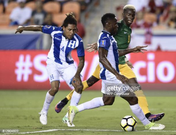 French Guiana's forward Arnold Abelinto tries to stop players from Honduras during the second half of the Honduras vs French Guiana 2017 CONCACAF...