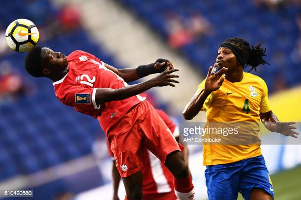 French Guiana's forward Rhudy Evens and Canada's midfielder Alphonso Davies vie for the ball during their 2017 Concacaf Gold Cup Group A match at the...