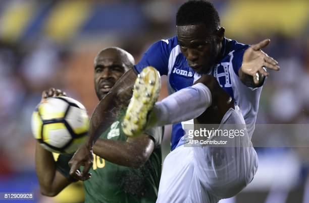 French Guiana's forward Sloan Privat looks on as Honduras's defender Maynor Figueroa kicks the ball during the second half of the Honduras vs French...