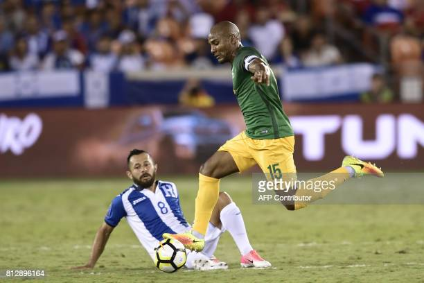 French Guiana's midfielder Florent Malouda drives past Honduras's midfielder Alfredo Mejia during the Honduras vs French Guiana 2017 CONCACAF Gold...