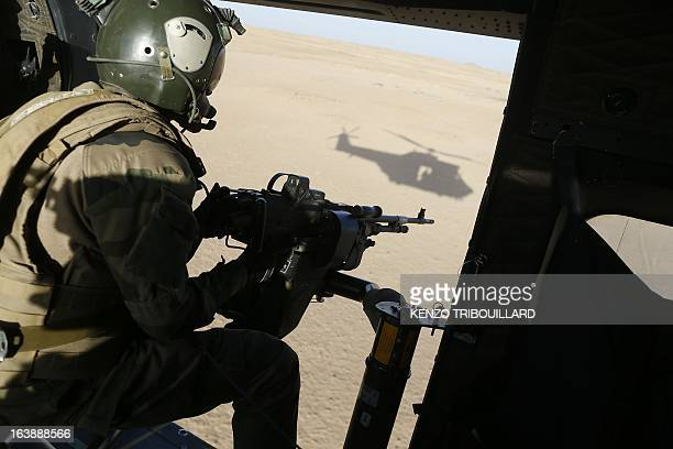 A French gunner sits in a Puma helicopter flying near Tessalit on March 17 2013 A French corporal was killed tracking down jihadist fighters in their...