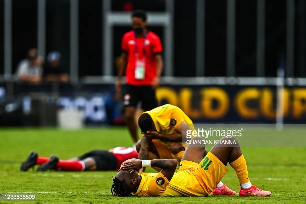French Guyana players react with disappointment after losing the game against Trinidad and Tobago during the Gold Cup Prelims soccer match at the DRV...