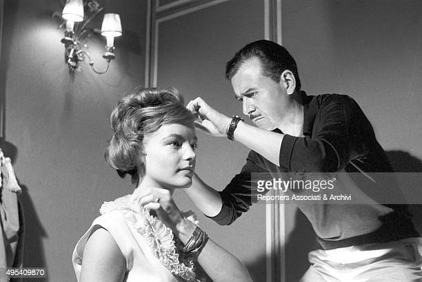 French hair stylist Alexandre de Paris combing Romy Schneider 's hair on the set of the film Boccaccio '70 The Germanborn French actress is the...