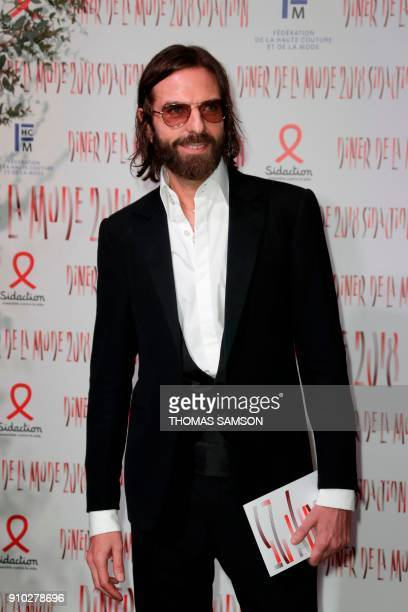 French hair stylist John Nollet poses upon arriving to the Diner de la Mode fundraiser dinner to benefit the French antiAIDS association Sidaction on...