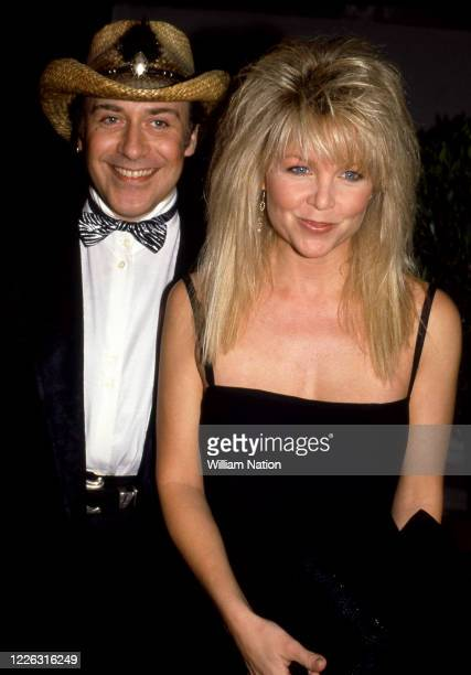French hair stylist Jose Eber and American actress and singer Lisa Hartman pose during the Women's Wear Daily party circa September 1987 at Elizabeth...