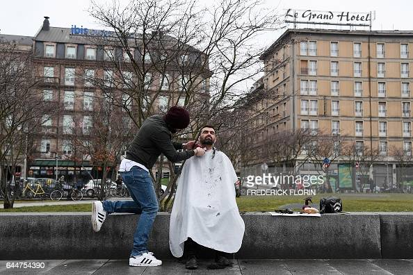 french hairdresser david kodat is at work with a homeless person in