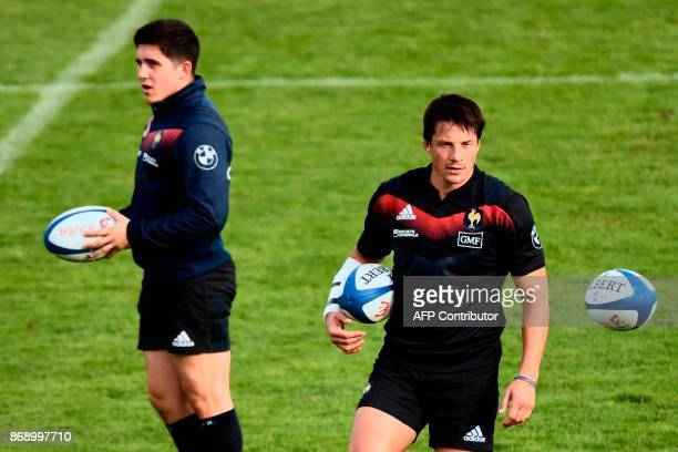 French half back Francois Trinh-Duc and French fly-half Anthony Belleau attend a training session of the French national rugby union team in...
