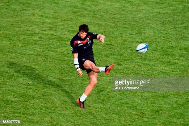 French half back Francois TrinhDuc clears the ball during a training session of the French national rugby union team in Marcoussis near Paris on...