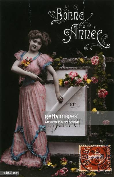 French Happy New Year postcard depicting a woman pointing to the new year 1900