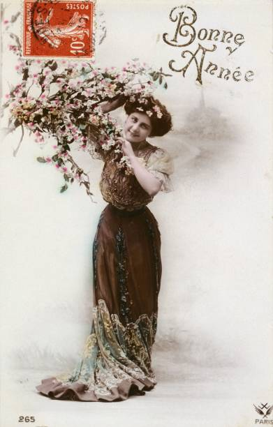 french happy new year postcard depicting a woman with a branch of flowers 1900