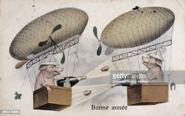 French Happy New Year postcard depicting two aeronauts aviators as celebrating pigs each opening champagne in a balloon circa 1900
